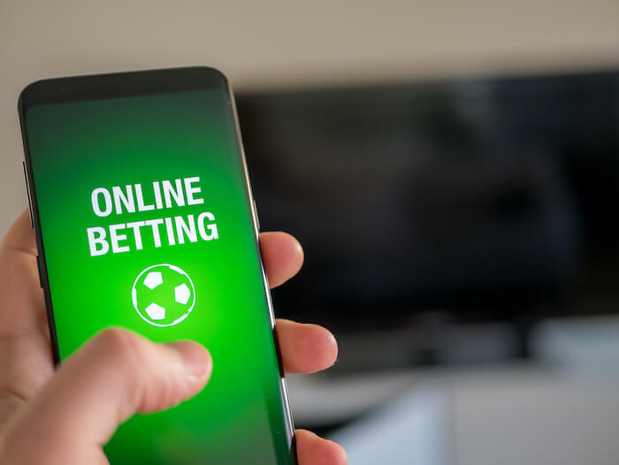 Bild på mobil med text Online Betting